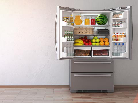 Picture of open fridge full of fresh food