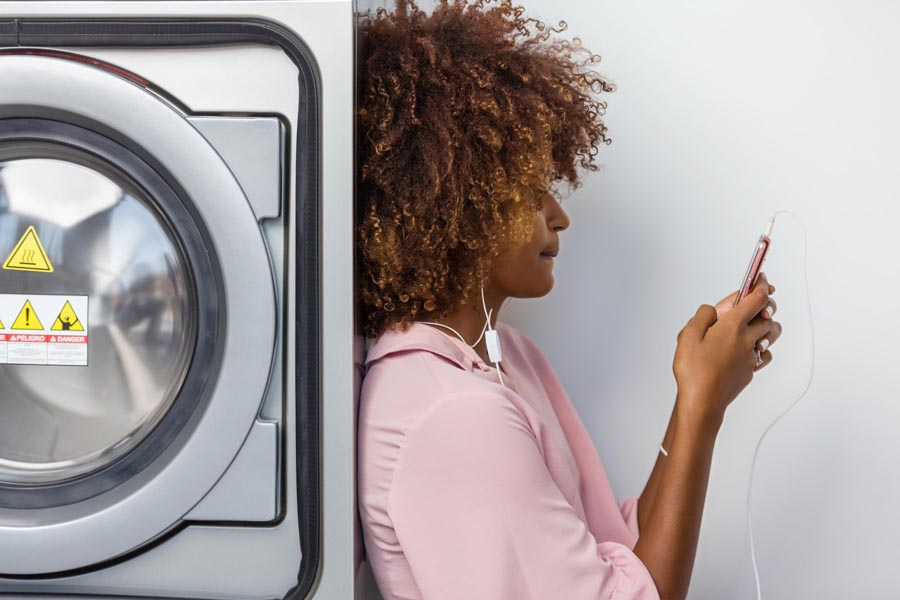 Girl leaning on Washing machine repair Frederick MD